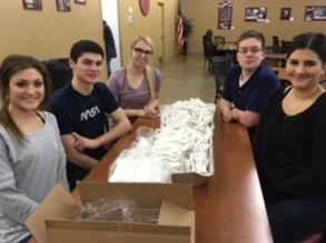 NHS students volunteering at Our Community Kitchen